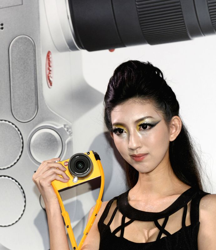 A model demonstrates a brand-new Leica T camera at a release ceremony in Taipei, southeast China's Taiwan, April 30, 2014. German camera manufacturer Leica released