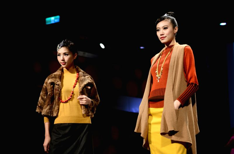 Models present creations during a Londee fashion show in Taipei, southeast China's Taiwan, Aug. 20, 2014. Fashion brand Londee released its new Autumn/Winter ...