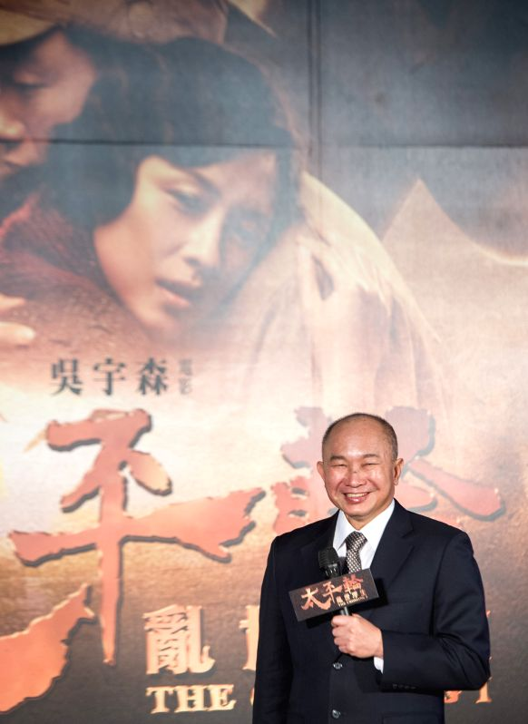 Director John Woo of Hong Kong attends the premiere of his movie The Crossing I in Taipei, southeast China's Taiwan, Dec. 2, 2014.