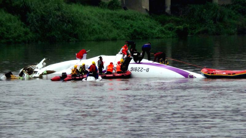 Rescuers work at the site of the plane accident in Taipei, southeast China's Taiwan, Feb. 4, 2015. A plane of the Taiwan TransAsia Airways came down into a Taipei ...