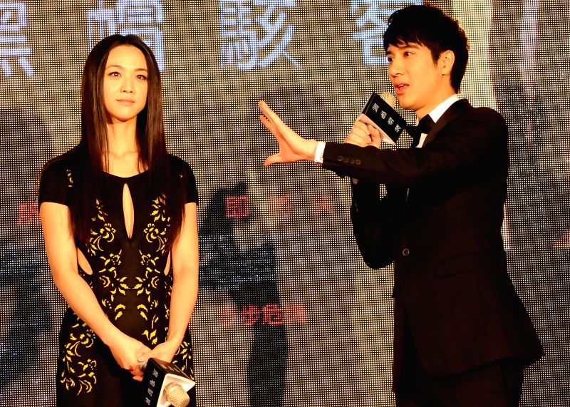 "Actress Tang Wei (L) and actor Leehom Wang react at the premiere of U.S. movie ""Blackhat"" in Taipei, southeast China's Taiwan, Jan. 15, 2015."