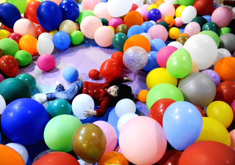 A kid plays in an exhibition of balloons at Taiwan Science Education Center in Taipei, southeast China's Taiwan, Jan. 23, 2015. A total of 300,000 balloons were ...