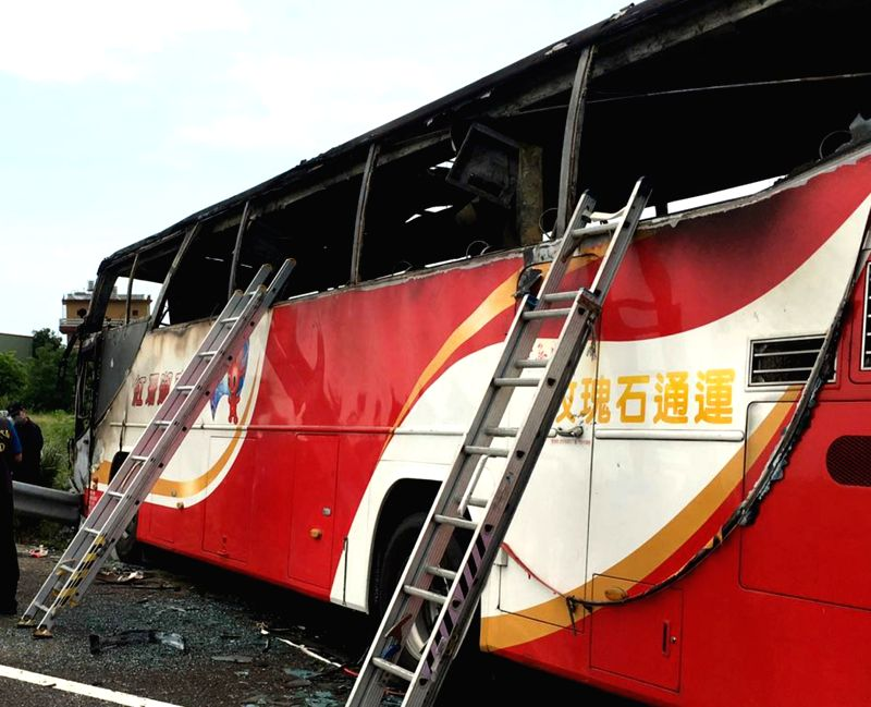 TAIPEI, July 19, 2016 - Photo taken on July 19, 2016 shows the accident site of a coach fire in Taipei, southeast China's Taiwan. A tourist coach caught fire on a highway near Taoyuan Airport on ...