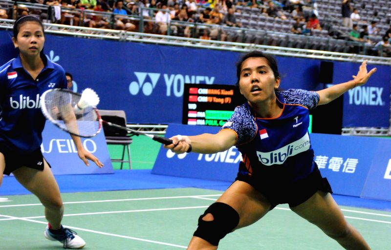 Greysia Polii (L) and Nitya Krishinda Maheswari (R) of Indonesia compete during the women's doubles final against China's Yu Yang and Wang Xiaoli at the Yonex Open ..