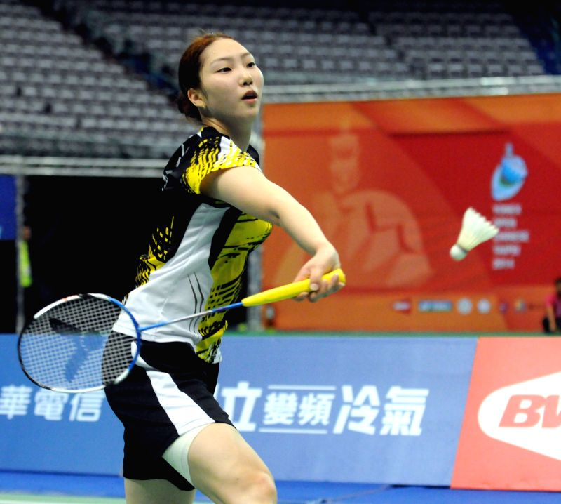 Sung Ji Hyun of South Korea competes with China's Liu Xin during the women's singles final at the Yonex Open Chinese Taipei 2014 badminton tournament in Taipei, ...