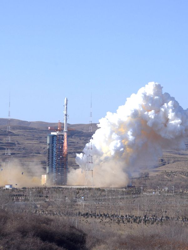 A Chinese Long March-4B rocket carrying the CBERS-4 satellite, jointly developed with Brazil, blasts off in Taiyuan satellite launch center in north China's Shanxi Province, Dec. 7, 2014. It
