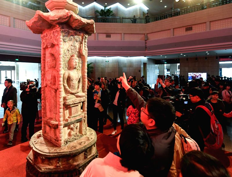 TAIYUAN, April 17, 2017 - Visitors view the Dengyu stone tower during a donation ceremony at Shanxi Provincial Museum in Taiyuan, capital of north China's Shanxi Province, April 16, 2017. A donation ...
