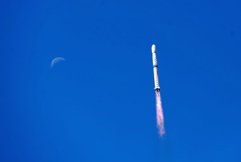 A Long March-4B carrier rocket carrying the Gaofen-2 satellite flies in the sky in Taiyuan, capital of north China's Shanxi Province, Aug. 19, 2014. China ...