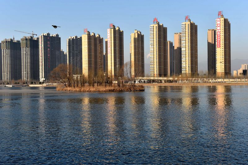 Photo taken on Jan. 16, 2015 shows residential buildings in Taiyuan, capital of north China's Shanxi Province. Home prices declined in most Chinese cities in ...