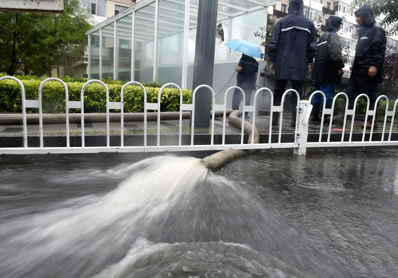 TAIYUAN, July 19, 2016 - Workers drain off water from a basement in Taiyuan, capital of north China's Shanxi Province, July 19, 2016. A heavy rain hit Taiyuan on Tuesday. The city's meteorological ...