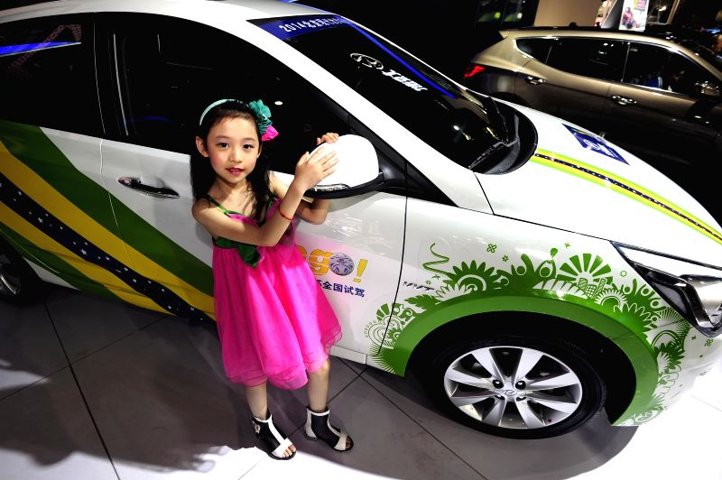A child model presents a Beijing Hyundai Verina during the 2014 China (Taiyuan) International Automobile Exhibition in Taiyuan, capital of north China's Shanxi ...
