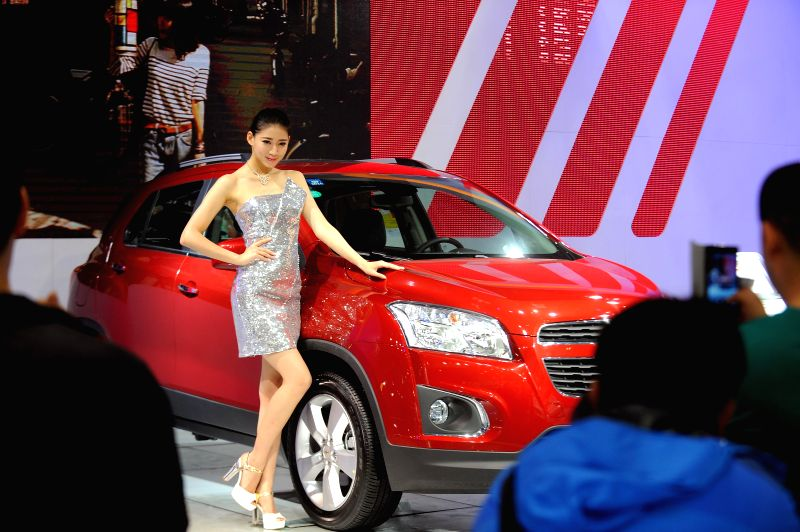 A model presents a Chevrolet Trax during the 2014 China (Taiyuan) International Automobile Exhibition in Taiyuan, capital of north China's Shanxi Province, May 15, ..