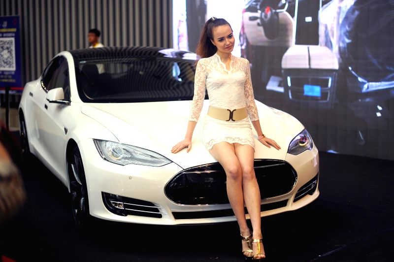 A model presents a Tesla during the 2014 China (Taiyuan) International Automobile Exhibition in Taiyuan, capital of north China's Shanxi Province, May 15, 2014. The .