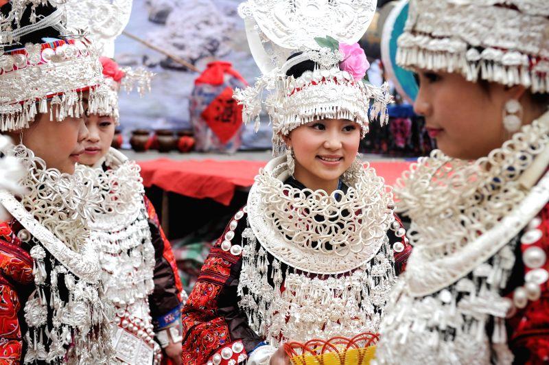 Girls of Miao ethnic group celebrate the Miao Sisters Festival in Taijiang County, Miao-Dong Autonomous Prefecture of Qiandongnan, southwest China's Guizhou ...