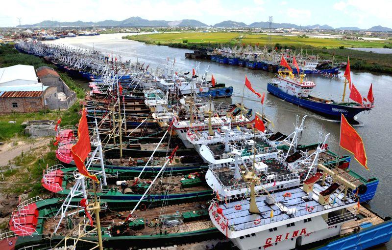 Fishing boats take shelter at the Jinqing Fishing Port to avoid Typhoon Matmo in Taizhou City, east China's Zhejiang Province, July 22, 2014. Typhoon Matmo, the ...