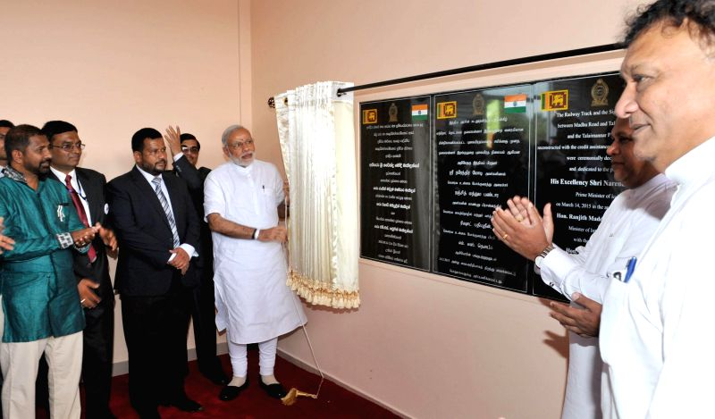 Prime Minister Narendra Modi unveiling the plaque to inaugurate the Talaimannar Pier Railway Station, in Sri Lanka on March 14, 2015. - Narendra Modi