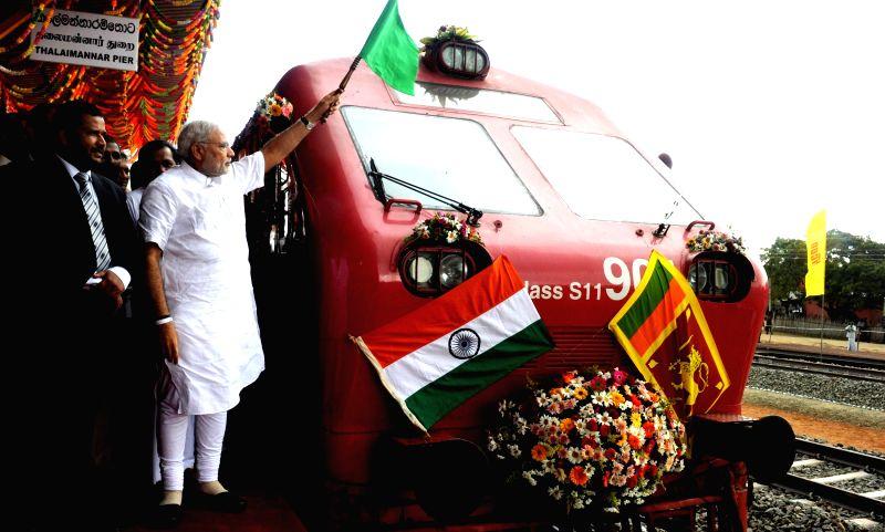 Prime Minister Narendra Modi flags-off the Talaimannar-Madu Road train, in Sri Lanka on March 14, 2015. - Narendra Modi