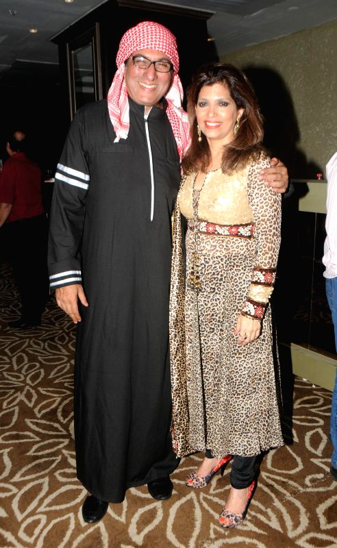Talat and Bina Aziz during Anup Jalota`s 56th birthday celebrations in Mumbai on July 29, 2014.