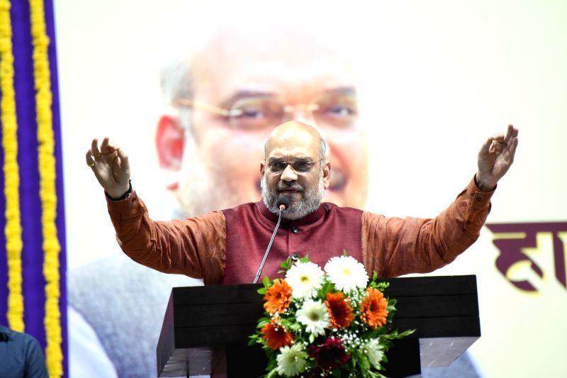 Taleigao (Goa): BJP chief Amit Shah addresses during a party programme at Dr Shyama Prasad Mukherjee Indoor Stadium in Taleigao, Goa on May 13, 2018.