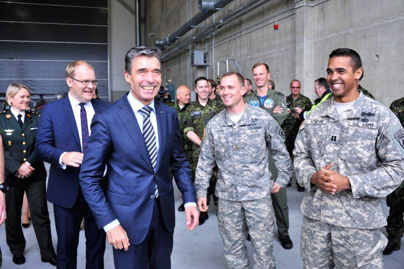NATO Secretary General Anders Fogh Rasmussen (C) visits Amari Air Base near Tallinn, the capital of Estonia, May 9, 2014.