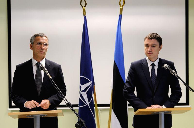 NATO Secretary General Jens Stoltenberg (L) attends a press conference with Estonian Prime Minister Taavi Roivas at Amari Airbase near Tallinn, Estonia, on Nov. 20, 2014. NATO Secretary ... - Taavi Roivas