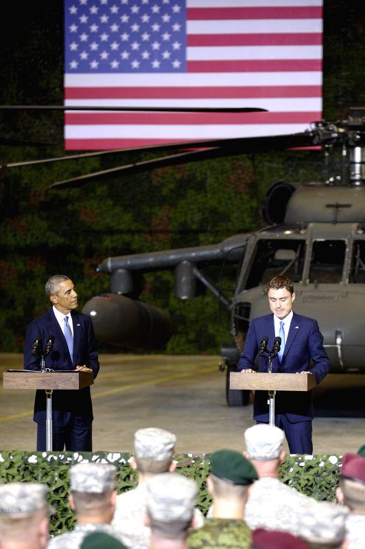 U.S. President Barack Obama (L) and Estonian Prime Minister  Taavi Roivas speak to US and Estonian service members at a airport in Tallinn, Estonia, Sept. 3, 2014, . - Taavi Roivas