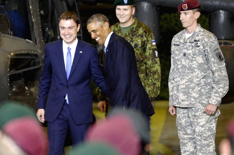 U.S. President Barack Obama (3rd R) and Estonian Prime Minister  Taavi Roivas shake hands after speaking to US and Estonian service members at a airport in Tallinn, - Taavi Roivas