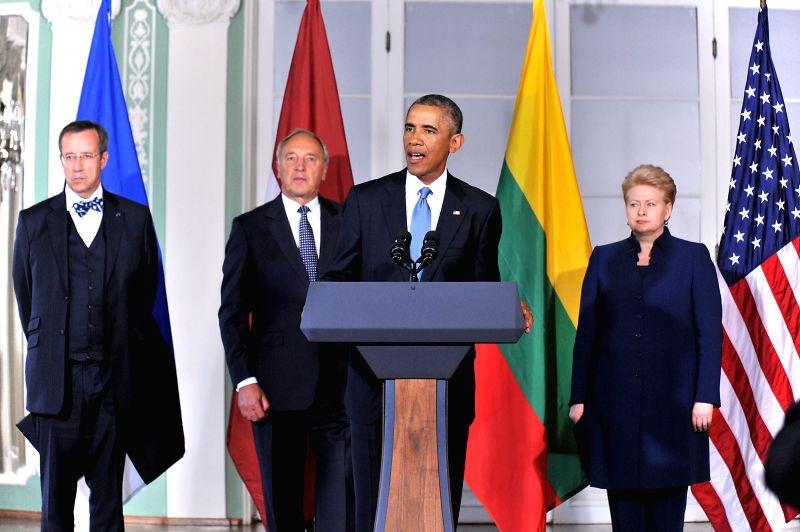 U.S. President Barack Obama (2nd R) speaks alongside Estonian President Toomas Hendrik Ilves (1st L), Latvian President Andris Berzins (2nd L) and Lithuanian ... - Taavi Roivas