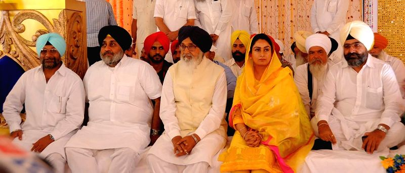 Talwandi Sabo: Punjab Chief Minister Parkash Singh Badal, Deputy Chief Minister Sukhbir Singh Badal and Union Minister of Food Processing Harsimrat Kaur Badal during a programme in Talwandi Sabo, ... - Parkash Singh Badal and Sukhbir Singh Badal