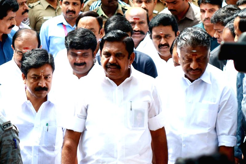 Tamil Nadu Chief Minister E K Palaniswami and deputy Chief Minister O Panneerselvam addressing the crowd outside the Kauvery Hospital where DMK chief M. Karunanidhi is admitted in Chennai on ...(Image Source: IANS)