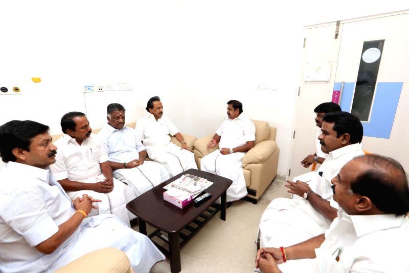 Tamil Nadu Chief Minister Edappadi K. Palaniswami, Deputy Chief Minister O. Panneerselvam and DMK Working President M.K. Stalin at Kauvery Hospital where DMK President M. Karunanidhi is ... - Edappadi K. Palaniswami