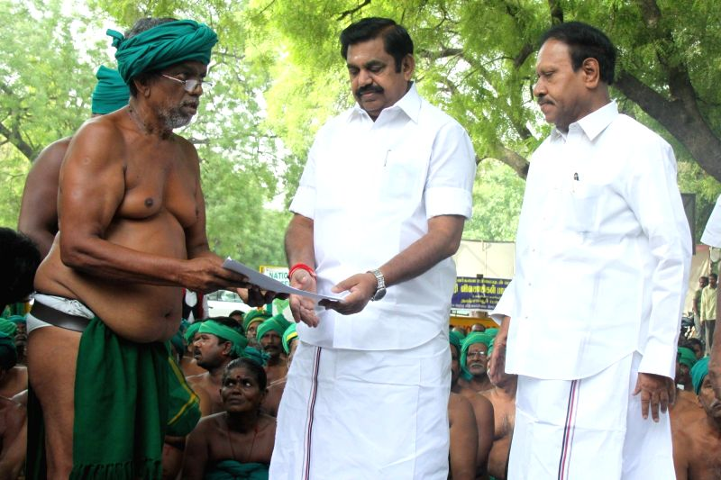 Tamil Nadu Chief Minister Edappadi Palaniswami meets protesting farmers from his state at the Jantar Mantar in New Delhi on April 23, 2017.In past 40 days of their protest the farmers have ... - Edappadi Palaniswami