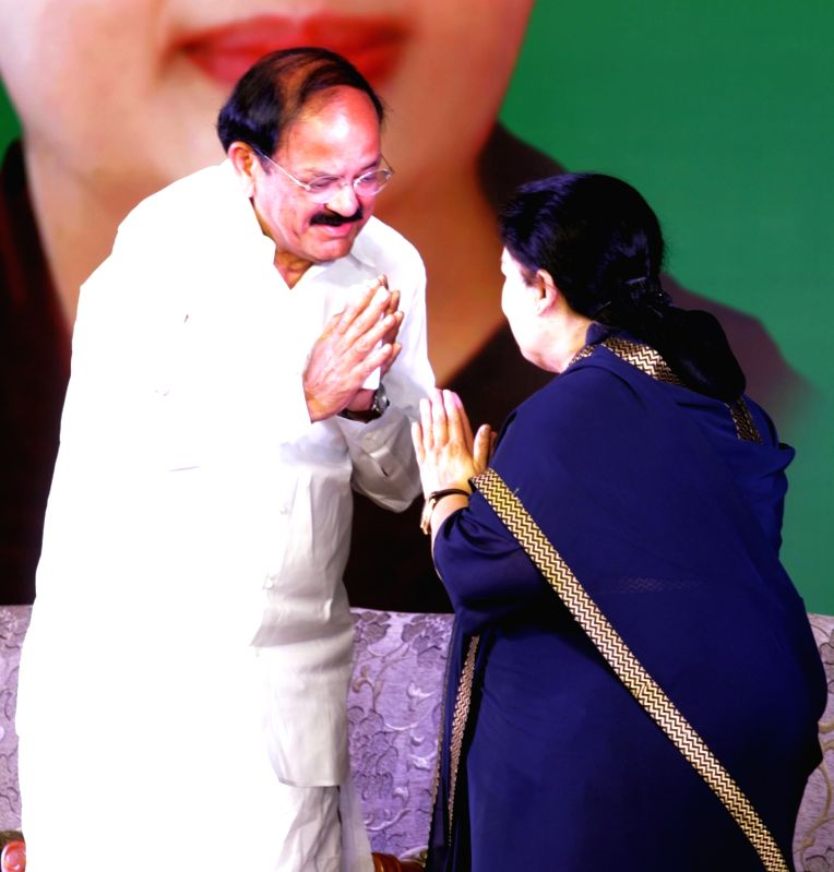 Tamil Nadu Chief Minister J. Jayalalitha and Union Minister Venkaiah Naidu during a programme in Chennai on July 23, 2016. - J. Jayalalitha and Venkaiah Naidu