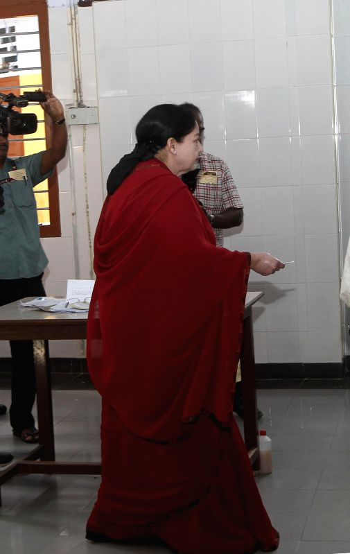 Tamil Nadu Chief Minister J Jayalalithaa arrives at a polling booth to cast her vote during the sixth phase of 2014 Lok Sabha Polls in Chennai on April 24, 2014.