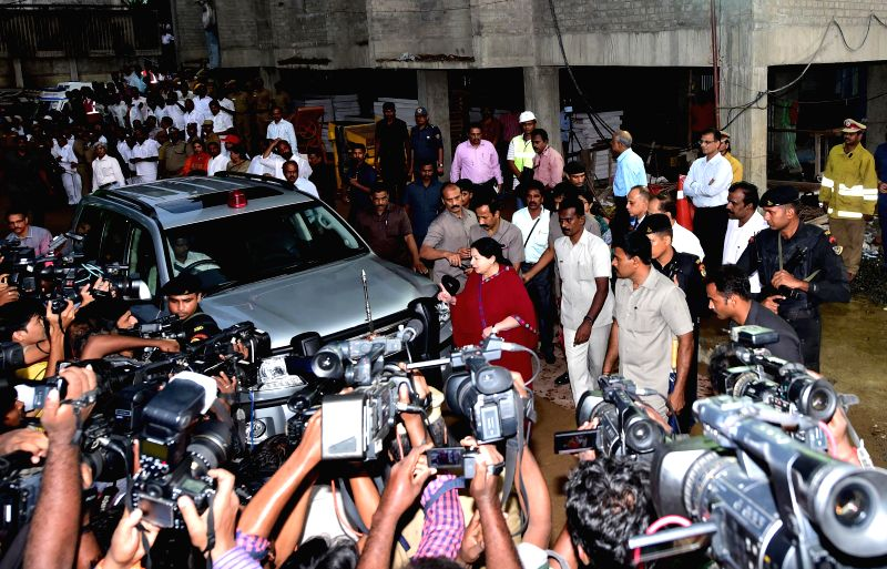 Tamil Nadu Chief Minister J Jayalalithaa arrives to meet the accident victims who were injured after a portion of a 11-storey under construction building collapsed at Moulivakkam in Chennai Saturday .