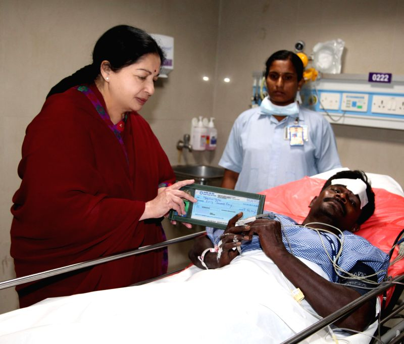Tamil Nadu Chief Minister J Jayalalithaa meets an accident victim who got injured after a portion of a 11-storey under construction building collapsed at Moulivakkam in Chennai Saturday evening, on ..