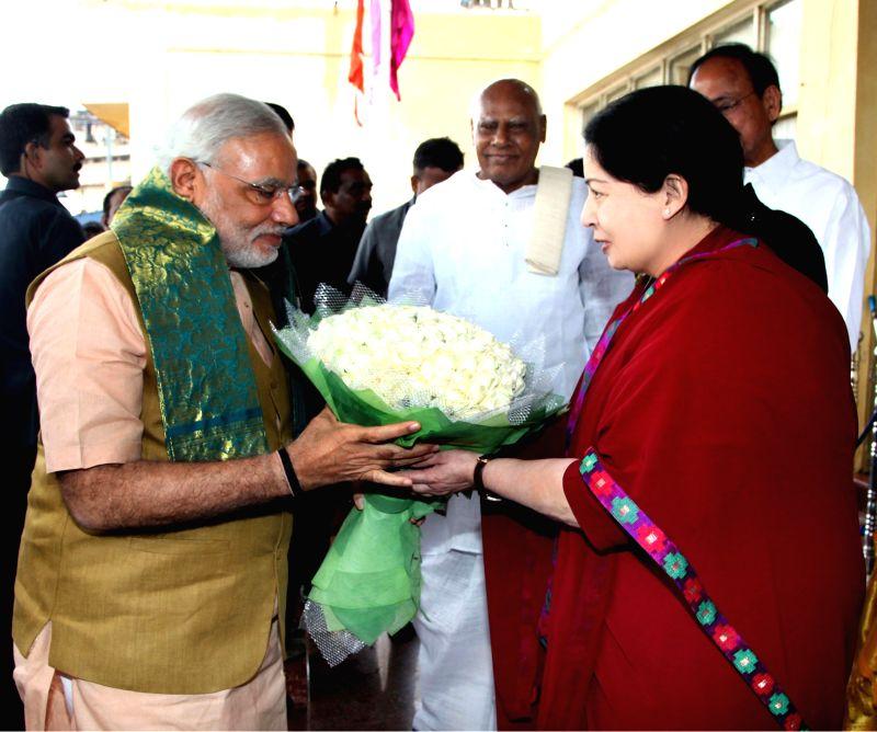 Tamil Nadu Chief Minister J Jayalalithaa welcomes Prime Minister Narendra Modi at Chennai Airport on June 29, 2014. - Narendra Modi