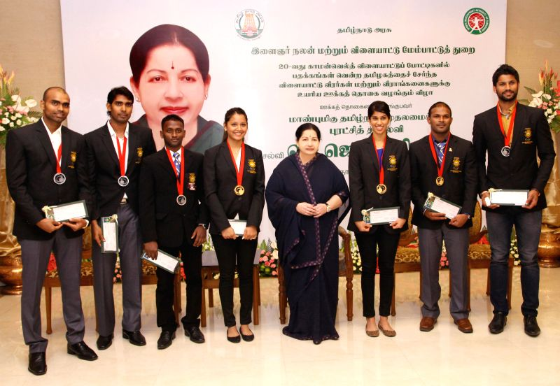 Tamil Nadu Chief Minister Jayalalithaa with Glasgow 2014 Commonwealth Games medalists during a felicitation programme in Chennai on Aug 11, 2014. - Jayalalithaa