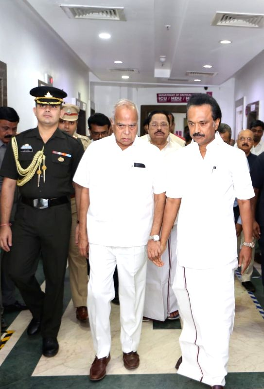 Tamil Nadu Governor Banwarilal Purohit accompanied by DMK leader and M. Karunanidhi's son M.K. Stalin during his visit to meet the DMK President who was admitted into the intensive care unit ...