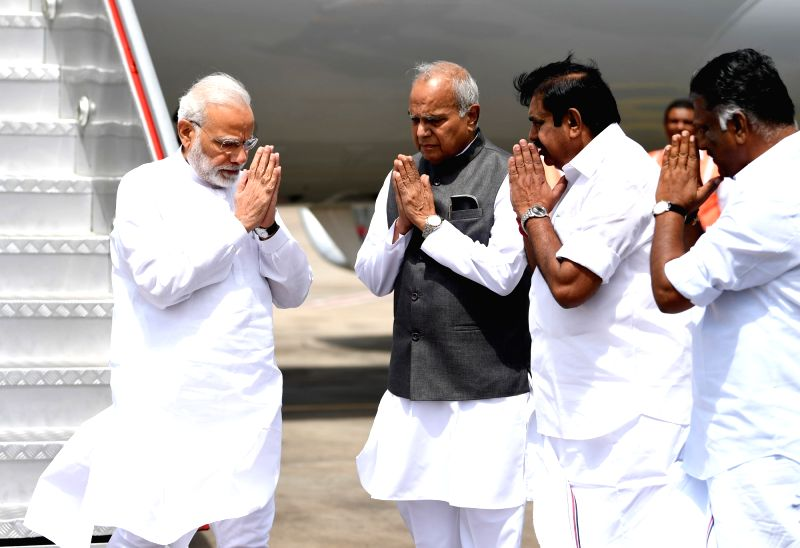 Tamil Nadu Governor Banwarilal Purohit, Chief Minister Edappadi K. Palaniswami and Deputy Chief Minister O. Panneerselvam receive Prime Minister Narendra Modi on his arrival in Chennai to ... - Edappadi K. Palaniswami and Narendra Modi