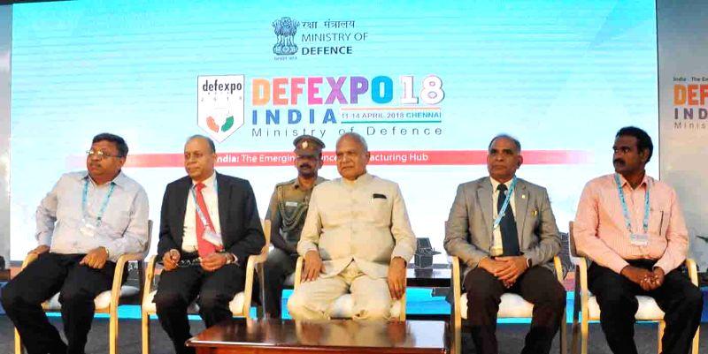 Tamil Nadu Governor Banwarilal Purohit, Defence Production Secretary Ajay Kumar and Hindustan Aeronautics Limited (HAL) Chairman and MD T. Suvarna Raju at the closing ceremony of DefExpo ...