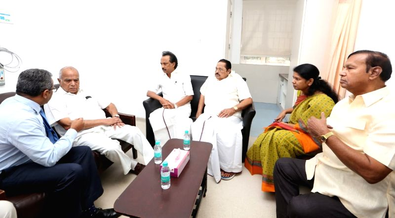 Tamil Nadu Governor Banwarilal Purohit, DMK leaders and M. Karunanidhi's children M.K. Stalin and Kanimozhi during their visit to meet the DMK President who was admitted into the intensive ...