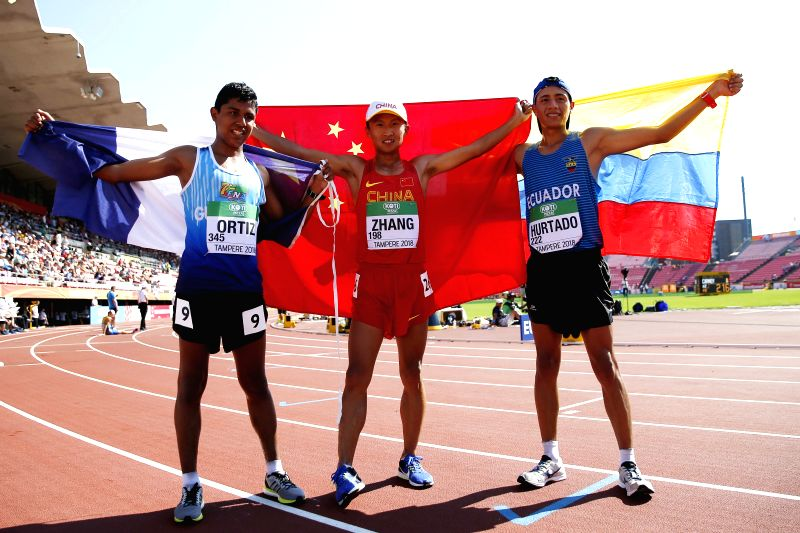 TAMPERE, July 14, 2018 - Zhang Yao (C) of China, Jose Ortiz of Guatemala, David Hurtado of Ecuador celebrate after the Men's 10,000 Metres Race Walk final at the IAAF (International Association of ...