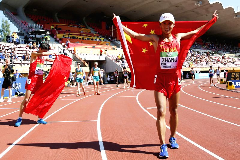 TAMPERE, July 14, 2018 - Zhang Yao (R) of China celebrates after the Men's 10,000 Metres Race Walk final at the IAAF (International Association of Athletics Federations) World U20 Championships in ...