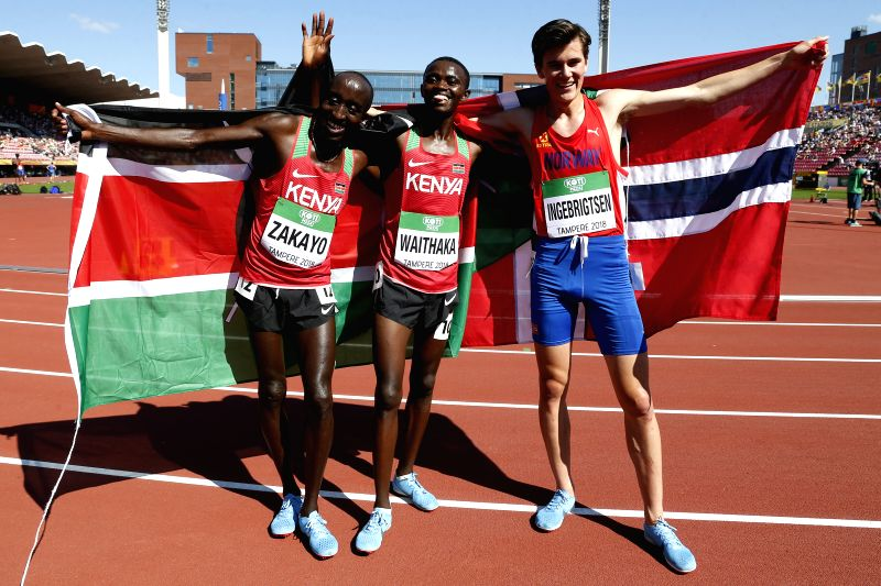 TAMPERE, July 15, 2018 - Edward Zakayo Pingua (L) of Kenya, Stanley Waithaka Mburu (C) of Kenya and Jakob Ingebrigtsen of Norway celebrate after the Men's 5000 Meters Final at the IAAF World U20 ...