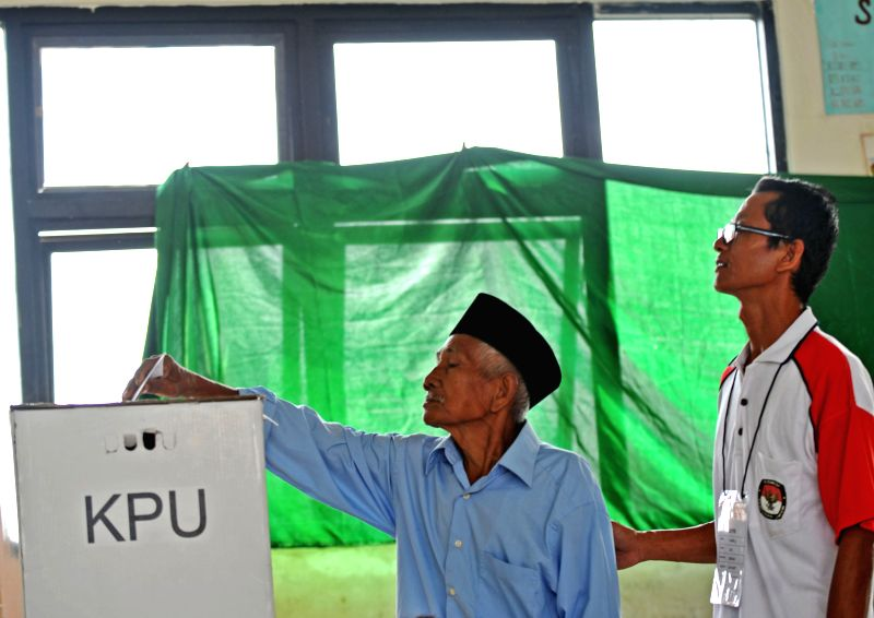 A man casts his vote at a polling station in Tangerang, Indonesia, July 9, 2014. Indonesians on Wednesday went to polls to pick up their new president for the ...
