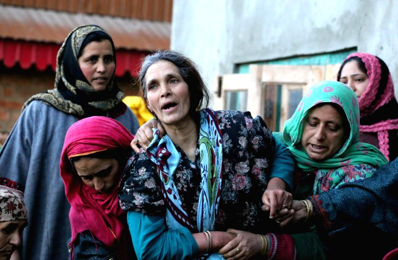 The family members of Bashir Ahmad, who was killed in an avalanche in Kongdoori heights near north Kashmir's Gulmarg ski resort mourn his death in Tangmarg of Jammu and Kashmir on Feb 11, ..