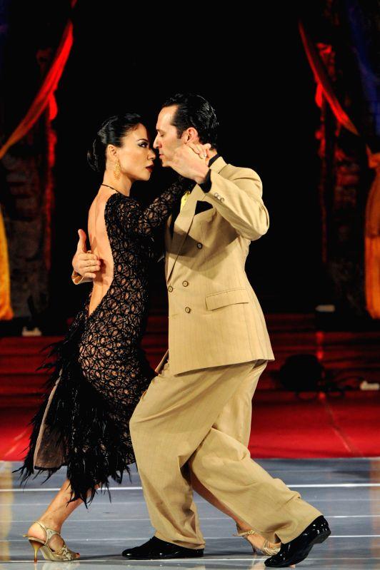 Tango dancers Cristian Lopez and Naoko Tsutsumizaki perform during the Tango in Paradise Festival at Denpasar in Bali, Indonesia, Nov. 28, 2015. Tango in Paradise ...