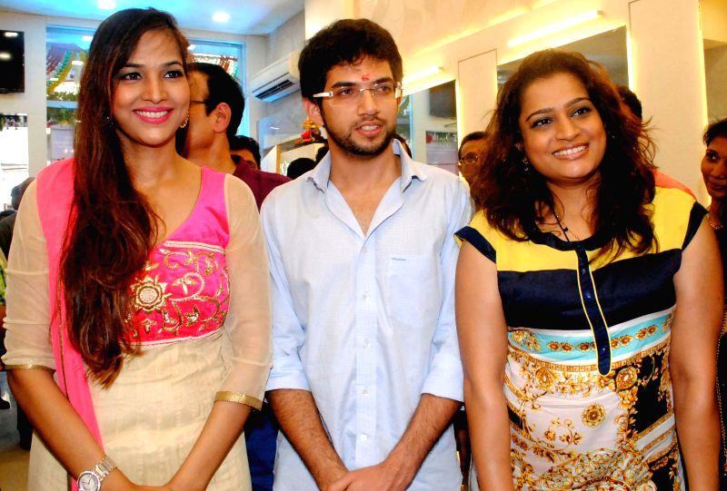 Tanisha Aingh,Aditya Thackeray and Ekta Jain during the opened Shivarama K Bhandary`s sixth hair design saloon in Mumbai on June 30, 2014. - Ekta Jain