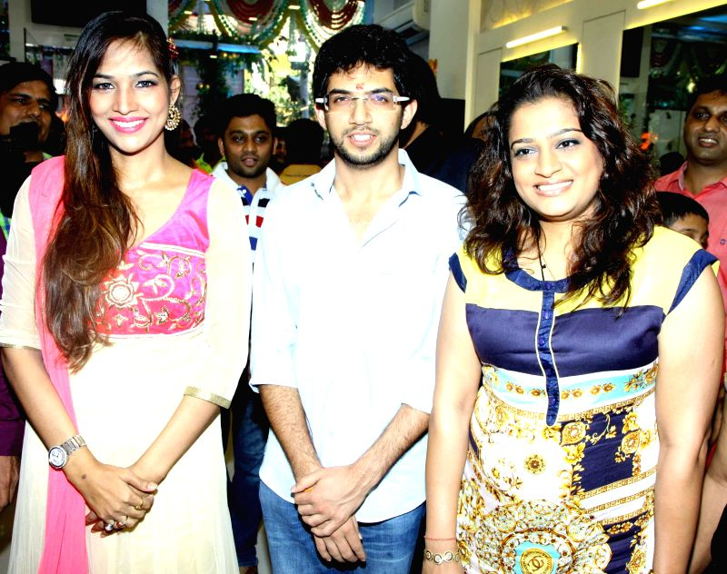 Tanisha Singh,Aditya Thackeray and Ekta Jain during the opened Shivarama K Bhandary`s sixth hair design saloon in Mumbai on June 30, 2014. - Tanisha Singh and Ekta Jain